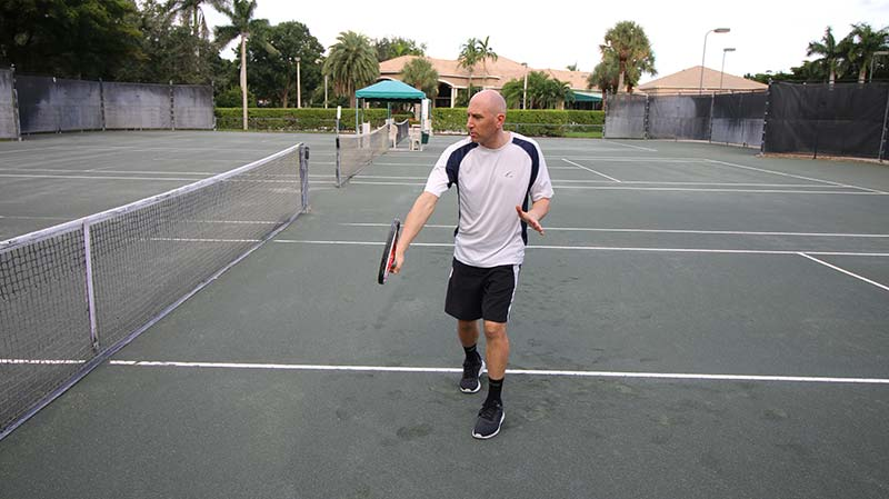 A block volley (backhand).
