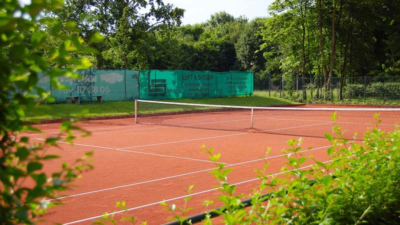 Clay tennis court.