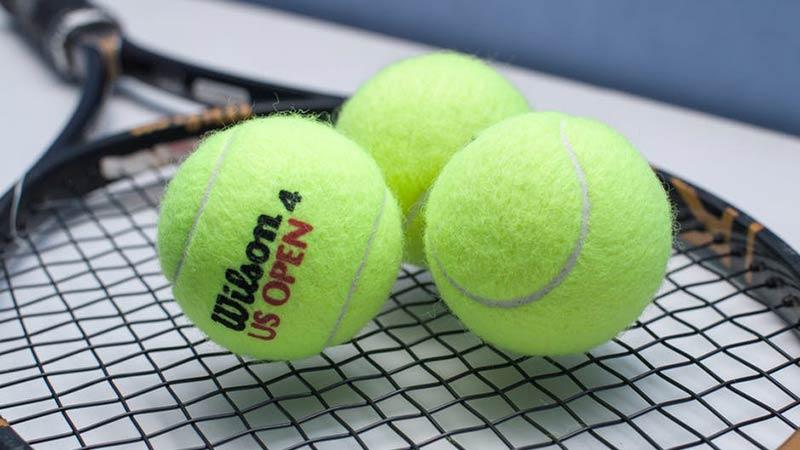 Racket with three tennis balls