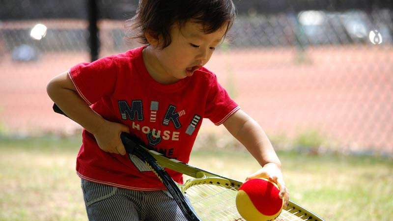 Very young tennis player.