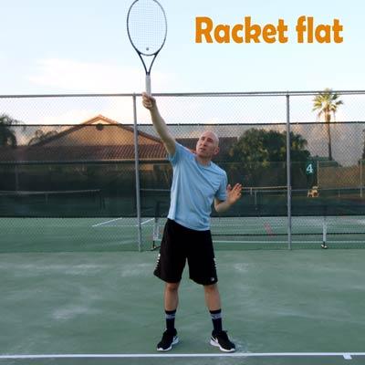 Racket flat.