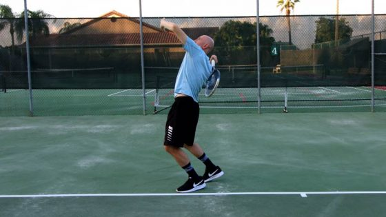 Body rotation for the serve (with racket drop).