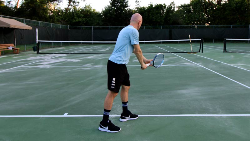 Body rotation for the serve (starting position).
