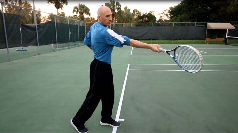 A traditional forehand has the arm extending out more after contact.