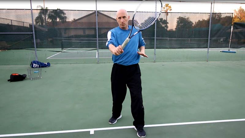 Allow the racket to flip to the other side of the body.