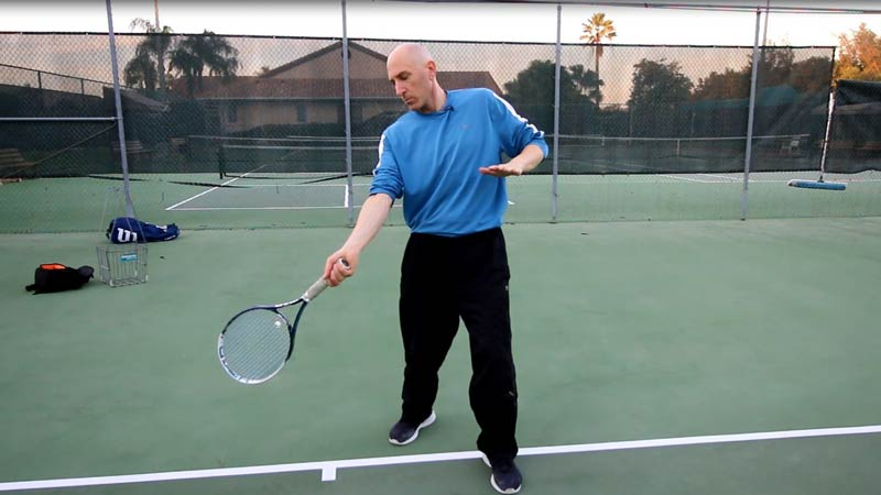 Contact the ball with the racket head below the ball.