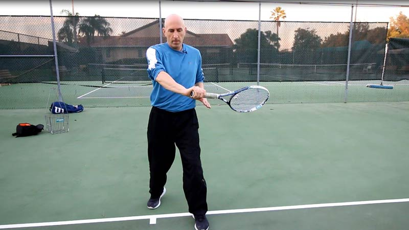 The racket will finish close to the waist at follow through.
