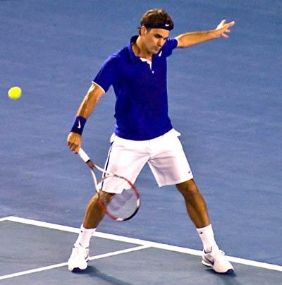 Federer hitting a slice.
